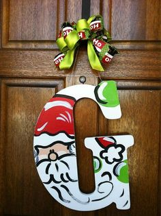 Cute way to paint a wooden monogram letter for Christmas. Santa Christmas Door Hanger by