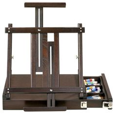 "A must-have for serious artists, this box table easel is ideal for use in the studio, in the classroom, at home or even outdoors. It can accommodate 13"" to 34"" canvases, and the built-in storage drawer conveniently keeps all of your favorite painting and drawing supplies within reach."