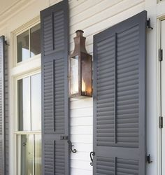This color gray for the shutters. But I think the kind I got is lighter than this. And it looks blue next to my blue door. :(