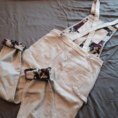 "interior floral print overalls NWT. Great Condition. Size M, TTS. Length- approx. 55"", Waist- approx. 16"" across, Inseam- approx. 26"", Rise- approx. 11"".   The fabric is slightly light that the print inside can be slightly/ faintly seen on the outside. Only when you really look closely. Doesn't look bad and Not a flaw. The small rips/tears on the legs are part of the design.  Not Modeling. No Hold. No Trade. Price is Firm. American Eagle Outfitters Pants Jumpsuits & Rompers"