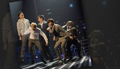 Simon Cowell: The sixth member of One Direction? The judge mixes it up with the boy band during THE X FACTOR UK in 2010.
