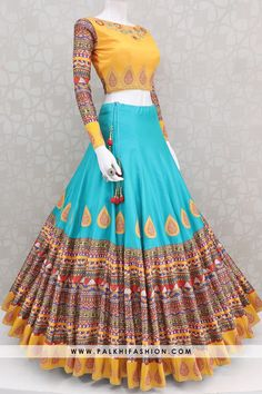 Palkhi fashion presents 12 meter flair chaniya choli with rich mix of royal colors & appealing prints. Party Wear Indian Dresses, Indian Fashion Dresses, Designer Party Wear Dresses, Indian Gowns Dresses, Indian Bridal Outfits, Dress Indian Style, Indian Designer Outfits, Indian Lehenga, Lehenga Gown