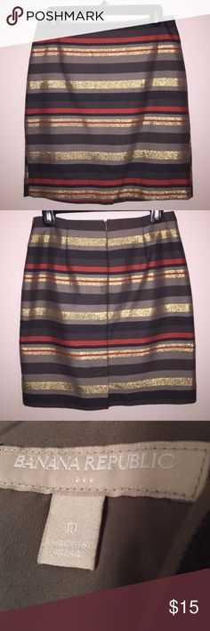 Brown & Metallic Striped Banana Republic Skirt This brown, orange and metallic gold striped skirt from Banana Republic Factory is adorable for fall and winter months. With a zipper closure, a small slit in the back, and a brown lining, this skirt is contemporary and well made. 56% cotton, 41% polyester, and 3% metallic. Lining is 100% polyester. Banana Republic Factory Skirts Mini