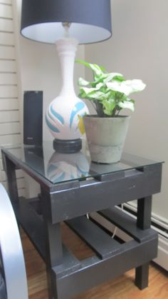 end table made from pallet cut to size with a piece of glass cut to fit