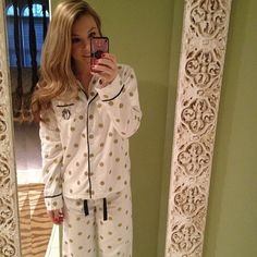 Polka dot pajamas with a monogrammed pocket (I like the room color, the mirror frame and the rug in the background!)
