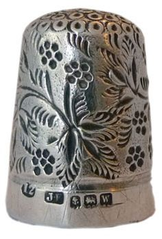 """James Fenton is known for his blackberry designs - here with an all over pattern of leaves with the berries. There are also stylised berries on the apex. Marked with size 12,""""JF"""" maker's mark, assay mark for Birmingham 1921"""