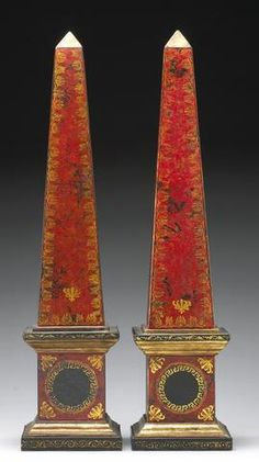 A pair of Florentine style polychrome tooled leather covered obelisks Late 20th Century.