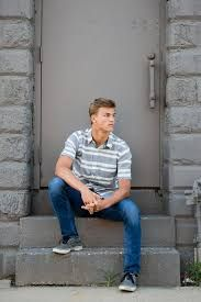 Senior guy casually poses for senior pictures in grand rapids Basketball Senior Pictures, Couple Senior Pictures, Senior Picture Props, College Senior Pictures, Senior Picture Makeup, Unique Senior Pictures, Country Senior Pictures, Senior Picture Outfits, Picture Poses