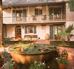 Mr. Hayes Town's courtyard - a classic  Koi pond in old sugar pot!