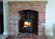 Reclaimed Norfolk Red Brick fireplace, Norfolk pamment hearth and Arrow Stove.