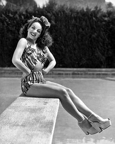Carmen Miranda by the pool, c.1940s...LOOK at those shoes!!!
