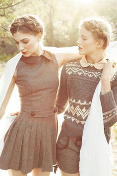"An ode to the Peter Pan collar. Dress on the left is sleeveless wool with fitted bodice, decorative ""martingala"" detail at waist and stitched down accordion pleated skirt. On the right, a detailed fair isle sweater tops a light blouse and is paired with woolen shorts, with trimmed cutaway pockets and buckle. Braids and orange lipstick. Period sepia toned backlit effect. Style Planet"