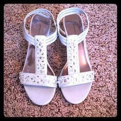 Silver sparkly low wedges size 7.5 Silver wedges with sparkly rhinestones, size 7.5. Good condition!! Attention Shoes Wedges
