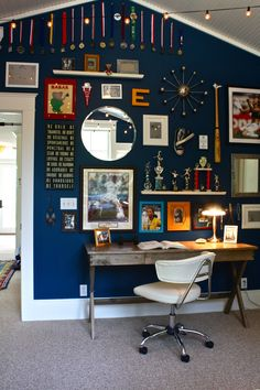 Super cute way to showcase lots of medals, trophies, etc. with a mixture of art, mirrors, photos, and even 3D objects. :)