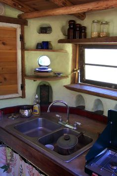Cob Kitchen - I love the counter space between the wall and the sink, good room for my soap bottles & scrubbies!