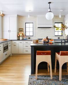 These Scandinavian-style rooms demonstrate how to master this cozy, minimalist look with style. #scandinaviankitchen #minimalist #scandinaviandecor #modernhomedecor #bhg Scandinavian Kitchen, Scandinavian Interior Design, Scandinavian Design, Painted Window Frames, Off White Cabinets, Mid Century Modern Kitchen, Built In Bench, Shaker Style, Kitchen Styling