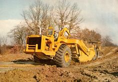Beautiful colour study of an Allis-Chalmers 460C loading damp clay on a Pittsburgh, USA, highway job in 1968. This is a very early production machine as the 460C was only introduced that year. Photo was taken in October so the trees are all beginning to lose their leaves prior to winter.