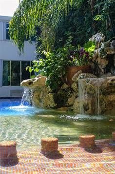 Tropical pool with waterfall in Playa del Carmen, Mexico