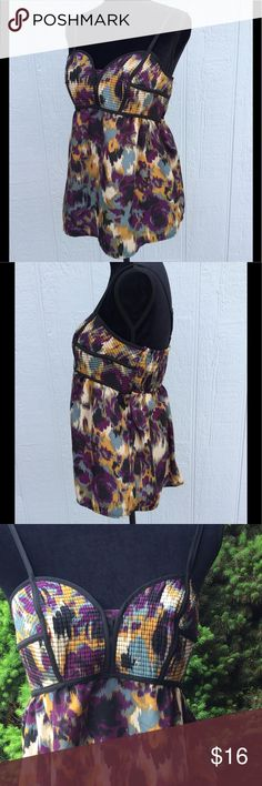 """Abstract printed corset style tank top Very unique abstract print tank top with corset style top half more fitted and looser bottom half, black piping nicely contours curves. Chest measures 18"""" across, Back has an elastic panel for added stretch. Total length 27"""" Straps are adjustable Xhilaration Tops Tank Tops"""