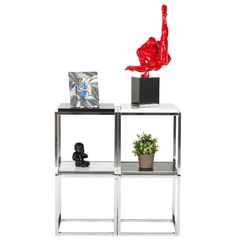 Red and Black Modern Kokoon Myron Decorative Statue DK00790REBL. The polyresin 'MYRON' is a homage to the antique games. An athlete in action is poised on a block of black marble.