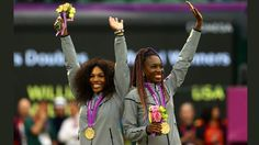 Gold medalists Serena Williams of the United States and Venus Williams of the United States celebrate on the popdium during the medal ceremony for the Women's Doubles Tennis on Day 9 of the London 2012 Olympic Games at the All England Lawn Tennis and Croquet Club on August 5, 2012 in London, England. (Photo by Paul Gilham/Getty Images)