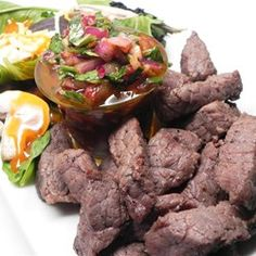 Grilled steak tips with chimichurri - The sauce is what makes these tasty steak tips so special.  Allrecipes.com