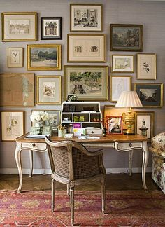 this is such an elegant desk...love the collection of vintage framed art