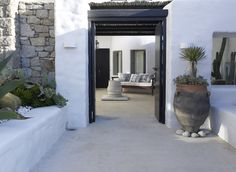 Seamless floor through spaces and balance with white. Nice for terrace through to area beyond arch