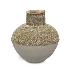 """BEADED BEACHCOMBER URN, SMALL by PALECEK Hand-beaded white washed coco wood urn with split rattan peel rim. Measurements: 11""""d x 12""""h"""