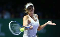 Maria Sharapova Photos: BNP Paribas WTA Finals: Day 4. Maria Sharapova of Russia plays a forehand against Petra Kvitova of the Czech Republic in their round robin match during the BNP Paribas WTA Finals at Singapore Sports Hub on October 23, 2014 in Singapore.