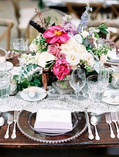 Low Centerpiece with Peonies, Roses, and Larkspur   Brides.com
