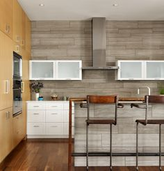 Vance Lane residence...kitchen designed with painted and natural wood finished cabinets. via dwell