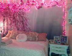 Fast, easy and beautiful bedroom wall. Floral photo backdrop on ebay. Strings of pink lights, tulle and glitter flower Christmas ornaments,  Use upholstery tacks to fasten to wall.