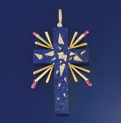 A Salvador Dali pendant designed as Latin cross, the carved lapis lazuli decorated with brilliant-cut diamonds and dangling ruby beads, together with a yellow gold chain