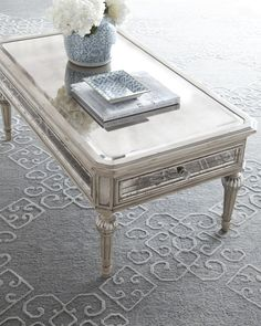 coffee table that feels like it belongs in Olivia Popes apartment - of course holding a glass of wine and popcorn