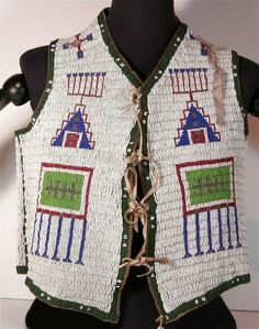 This rare and very beautiful, Sioux Beaded Buffalo Hide Vest is in excellent condition. It is NOT a reproduction or modern recreation but an original Beaded Sioux Vest, hand crafted in the late century. Native American Clothing, Native American Beading, Seed Bead Earrings, Beaded Earrings, Seed Beads, Bead Crochet Rope, Civil War Photos, Peyote Stitch, Brick Stitch