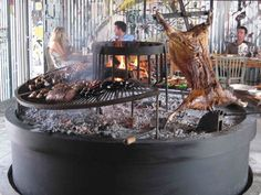 Estancia Vik (Jose Ignacio, Uruguay): traditional asado thanks to a striking barbeque pit in a room plastered in graffiti art Outdoor Oven, Outdoor Cooking, Outdoor Fire, Fire Grill, Bbq Grill, Asado Grill, Gas Fire Pit Table, Fire Cooking, Smoker Cooking