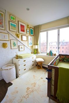 This small nursery is just darling! The exposed brick adds so much character to the room. /BR | Apartment Therapy