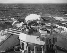 The barrells of the main armament of nine 16-inch (406 mm) guns mounted in triple turrets on the Royal Navy Nelson-class battleship HMS Rodney are elevated whilst cruising the off Scapa Flow with the Home Fleet on 1 February 1944 somewhere in the Atlantic Ocean off Scapa Flow in the Orkney Islands. HMS Rodney played a major role in the sinking of the German battleship Bismarck in 1941 during World War 2. (Photo by Keystone/Hulton Archive/Getty Images).