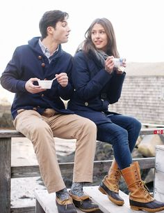 A navy wool parka and khaki chinos paired together are the ideal outfit for those who prefer relaxed styles. Does this outfit feel too polished? Introduce black and tan snow boots to mix things up a bit. Duck Boots Outfit, Snow Outfit, Tall Duck Boots, A Well Traveled Woman, Ll Bean Boots, The Brunette, Jogger, Boating Outfit, Cosplay