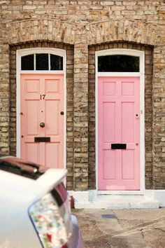 These pink doors make this stone architecture so much happier