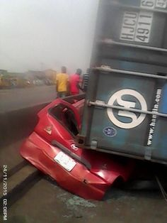 SO SAD: SEE How Container Crushed Car To Pieces In Lagos (Photo) - http://www.thelivefeeds.com/so-sad-see-how-container-crushed-car-to-pieces-in-lagos-photo/