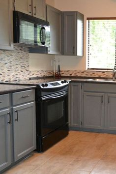how to decorate a kitchen with black appliances and benjamin moore chelsea gray painted oak cabinets. Update ideas
