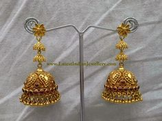 Traditional Indian gold jhumka earrings in long design made with antique finish 22 karat gold. The floral design small top with step design long earrings sayar Gold Jhumka Earrings, Jewelry Design Earrings, Gold Earrings Designs, Gold Bangles Design, Gold Jewellery Design, Jhumka Designs, Gold Jewelry Simple, Jewelry Patterns, Indian Jewelry