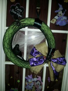 My pool noodle halloween wreath! Made with a green pool noodle, spider web fishnet tights, ribbon and some dollar store decorations!! I live how it turned out!!