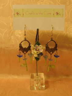 Beautiful Gold tone Flower Stamping Blue Flower Earrings  by crafts4thecure ♥etsy♥  $8.50
