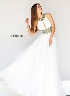 We love this dress @ The Bridal Gallery. www.thebridalgallery.com