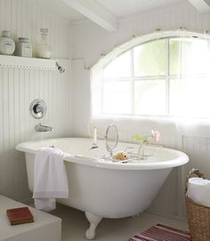 Pitched ceilings in the bathroom of this tiny Florida cottage made a standard-height shower a no-go, so the owner chose a deep cast-iron bathtub instead. Clawfoot Tub Bathroom, White Bathroom, Small Bathroom, Parisian Bathroom, Cozy Bathroom, Family Bathroom, Bathroom Curtains, Shabby, Beautiful Bathrooms