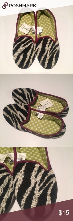 NWT zebra print slippers NWT zebra print slippers with fun polka dot print inside. Never worn. Shoes Slippers