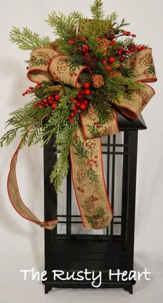 Check Out 21 Inspiring Christmas Lanterns For Indoors And Outdoors. You may say that a lantern is an old-fashioned piece, that it's not modern but a lantern makes the space cozier, it brings light, warmth and comfort, it's a cool idea for Christmas. Christmas Swags, Noel Christmas, Outdoor Christmas, Rustic Christmas, Winter Christmas, Xmas Wreaths, Christmas Flowers, Christmas 2017, Christmas Arrangements